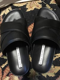 pair of black leather slide sandals Portland, 97239