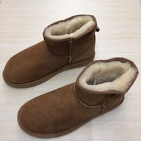 Pair of brown suede slip-on shoes 560 km