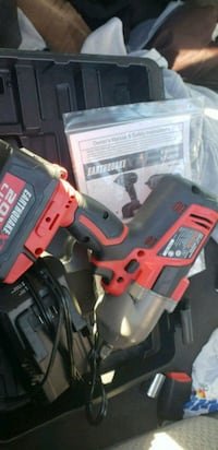 red and black Milwaukee cordless power drill 987 mi
