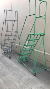 green and gray steel ladders