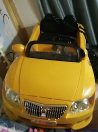 Yellow and black ride on toy car