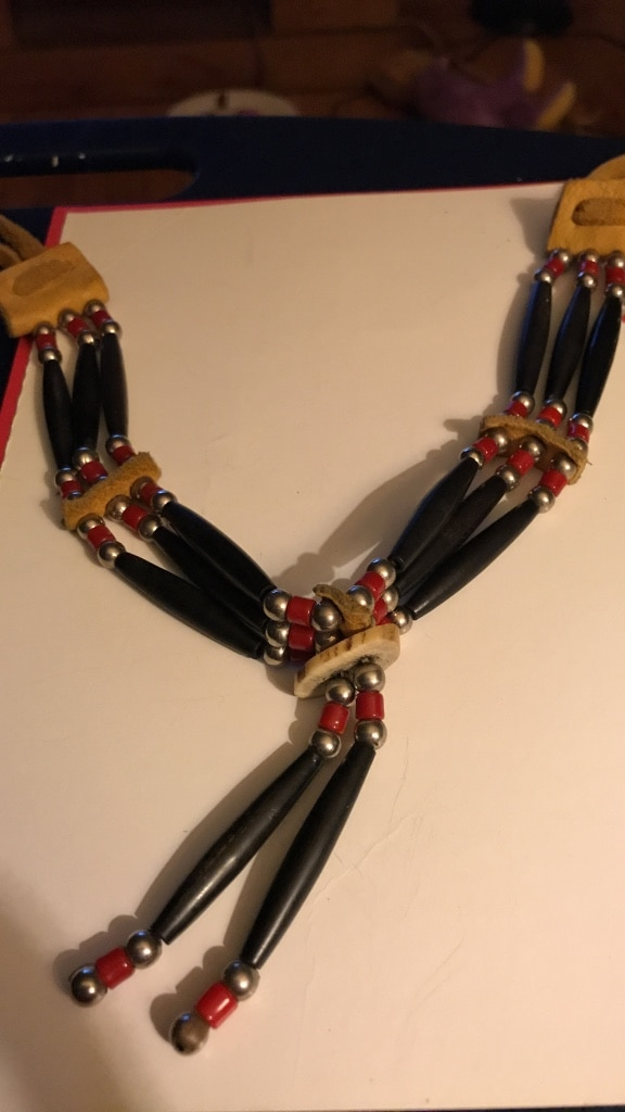 black, brown, and red bracelet