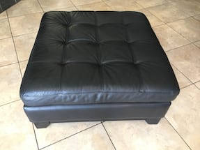 Large tufted black leather ottoman