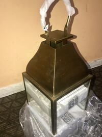 It's an indoor/outdoor lantern. Brass painted 16/8 size from pottery barn