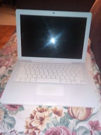 white and black laptop computer