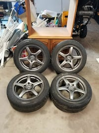 4 rims and two like new snow tires Medina, 14103