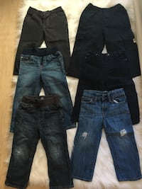 two blue and black denim jeans