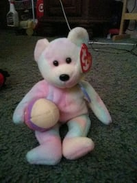 white and pink bear plush toy null