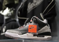 unpaired black and white Air Jordan 3 shoe
