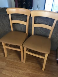 two brown wooden framed white padded chairs 2267 mi