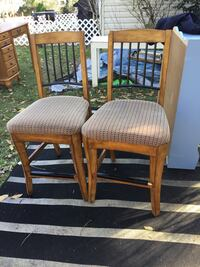 two brown wooden framed gray padded chairs 34 mi