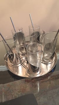 six glass cups with stainless steel handle