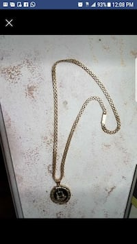 gold-colored chain link necklace screenshot