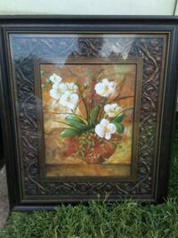 brown wooden framed painting of flowers Norman