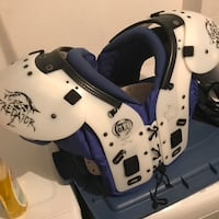 White and blue football shoulder pad Markham, L3S 4C6