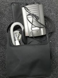 black and gray corded Respiratory  device null