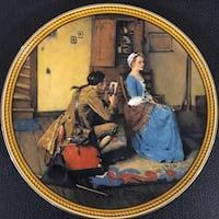 woman in blue dress sitting on brown wooden chair beside man kneeling cutting photo decorative plate Brentwood Bay, V8M 1A3