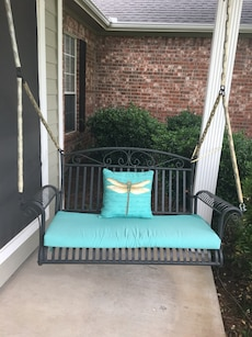 black metal swing bench with blue pad