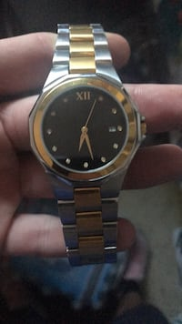Round gold-colored analog watch with link bracelet 400 mi