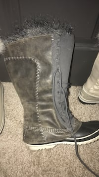 unpaired brown and black leather duck boot