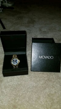 round blue-and-gold-colored Movado analog watch with linked strap London, 43140