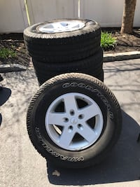 5 255/75/R17 Goodyear Wrangler tires and 5 rims.