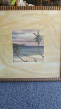 palm tree near body of water painting with brown wooden frame