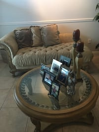 Elegant neutral tone chaise with antique gold wooden frame. Table included. Matching loveseat also available   935 mi