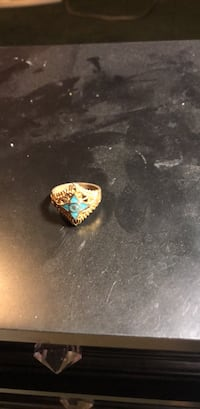 gold-colored ring with blue gemstone Santa Fe, 87507
