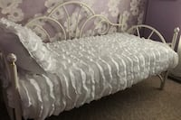 White frame daybed with white ceramic flowered knobs. Mattress not included. Bedspread and sham are negotiable Woodstock, 22664