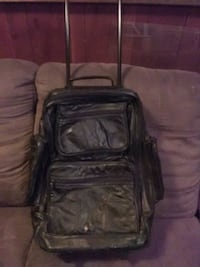 Black leather pull luggage with wheels