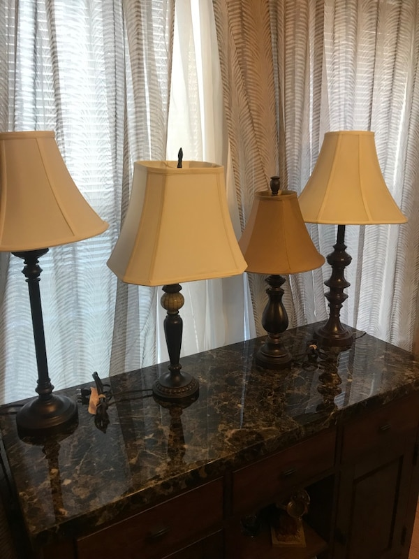 two brown wooden base white shade table lamps