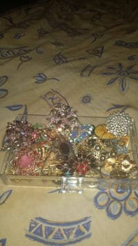Box full of vintage brooches
