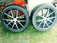 """Set of four rims and tires.  20""""rims great condition good tread Wyoming"""