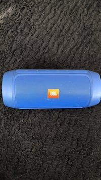 Blue jbl charge 2+ bluetooth speaker