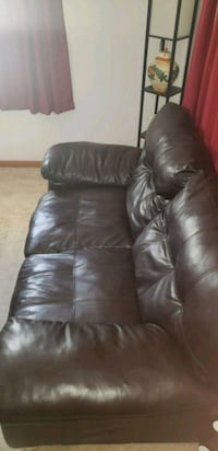 Chocolate brown faux leather loveseat New Carlisle, 45344