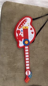 red and white Fisher-Price guitar plastic toy