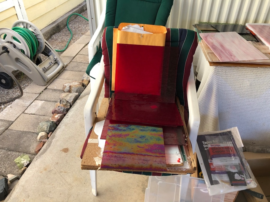 Photo Saw&grinder, books,sheets of glass,scraps,&tools for stained glass
