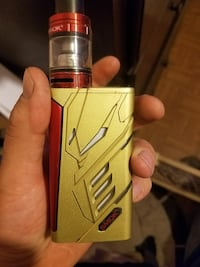 brass and red Smok variable vape mod