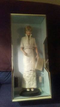 blonde haired woman doll in box