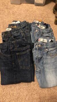 two blue and one black denim bottoms Martinsburg, 25401