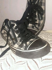 pair of black-and-white Adidas sneakers Roanoke, 24012