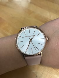Round silver-colored analog watch with white leather strap 1190 mi