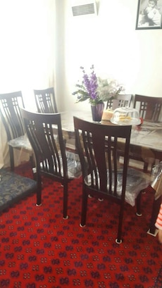 brown wooden dinning table set
