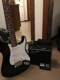 black and white stratocaster electric guitar with amplifier Albany, 12205