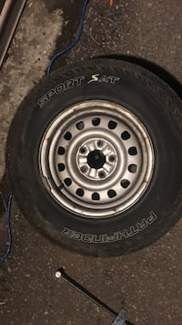gray 5-lug auto wheel with tire