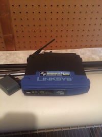blue and black linksys wireless modem router Lincolnton, 28092