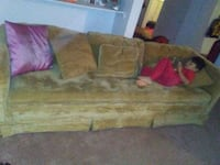 Long yello gold couch Lubbock, 79410