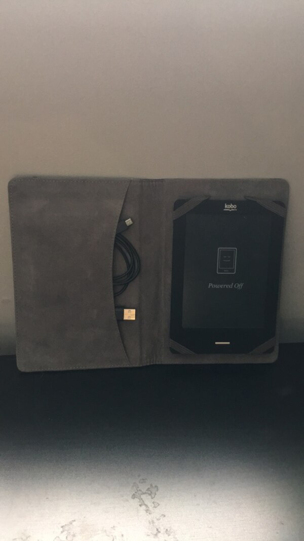 Kobo EReader(Comes with charger and case)