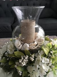 Beautiful candle with floral piece and mirrored base